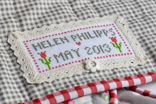cross stitch quilt label by Helen Philipps: Petunias, Bluebells and a Tulip Quilt