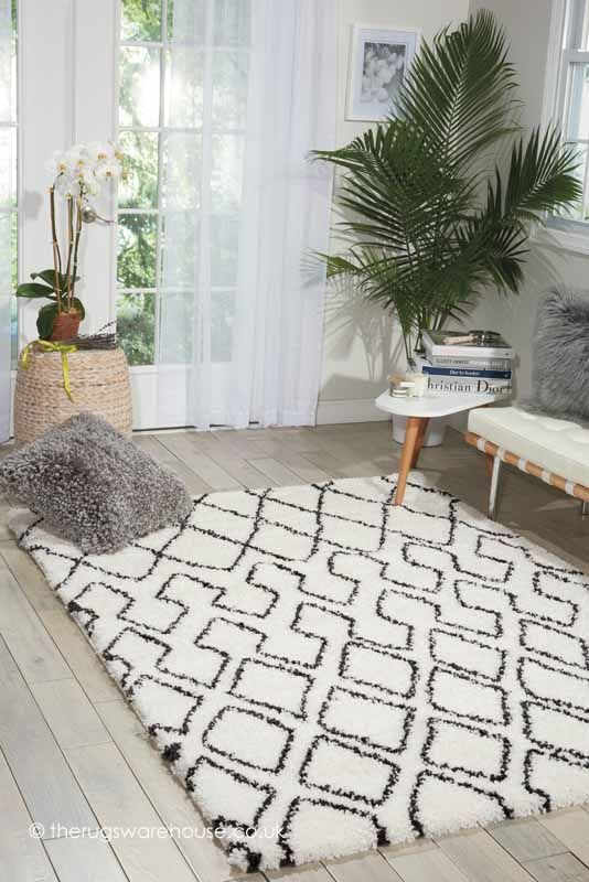 Riad Ivory Charcoal Rug (Calvin Klein Home), a soft and dense modern shaggy rug in charcoal grey & ivory pattern (machine-woven, 100% polypropylene, 3 sizes) http://www.therugswarehouse.co.uk/shaggy-rugs/riad-tribal-rugs/riad-ivory-charcoal-rug.html