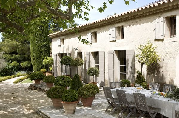 a home in Provence with tile roof.  Wood be nice without the shutters