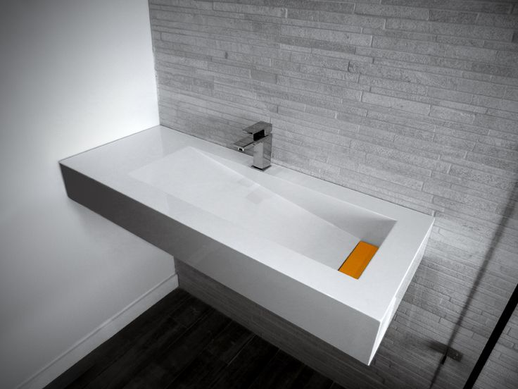 "LIA, A remarkable new design that adds a peaceful beauty and serene spa style to any bathroom by giving the basin a waterfall-like feel. This basin also comes with a col- our customizable hidden drain so you can add a pop of vibrant colour to accent your bathroom decor.  Descriptions: - Above-counter / Drop-in - Drain & hidden linear drain cover sold separately Available: - Colour Me Series - Lip Size: 1"" / 2"" / 4"" / 6"" - No faucet hole / Single hole centerset  faucet drilling"