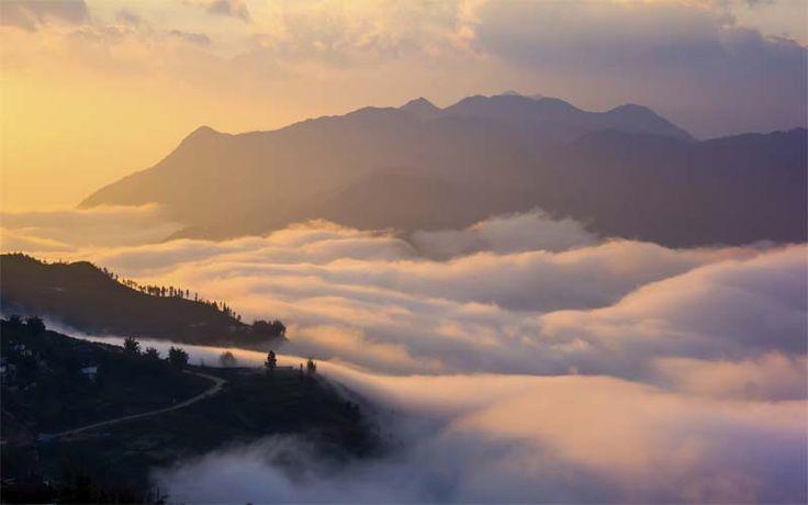 Zonsondergang in de bergen van Sapa. Uw trekking naar de top van de berg wordt beloond met een spectaculair uitzicht!