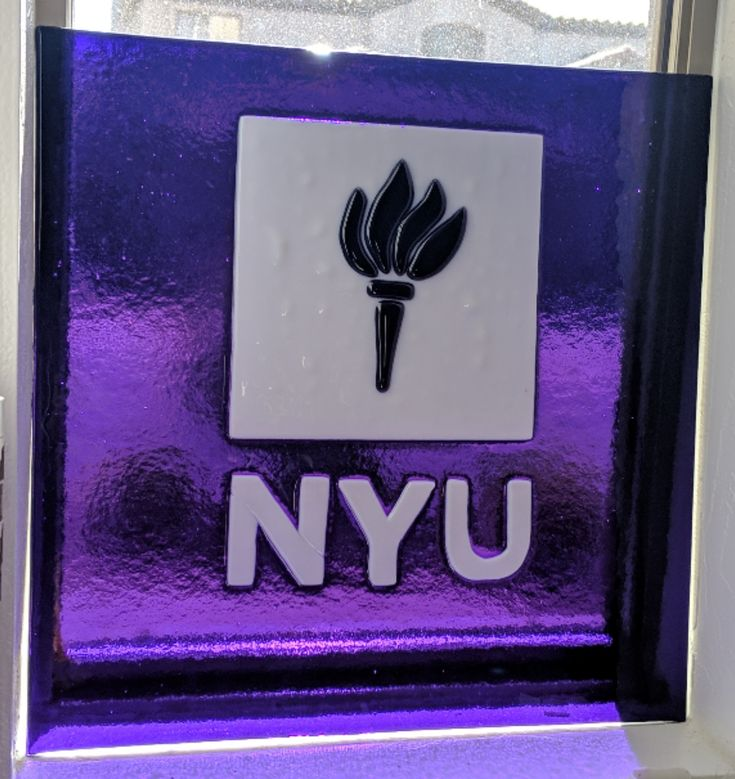 I made this nyu logo in fused glass as a surprise gift for