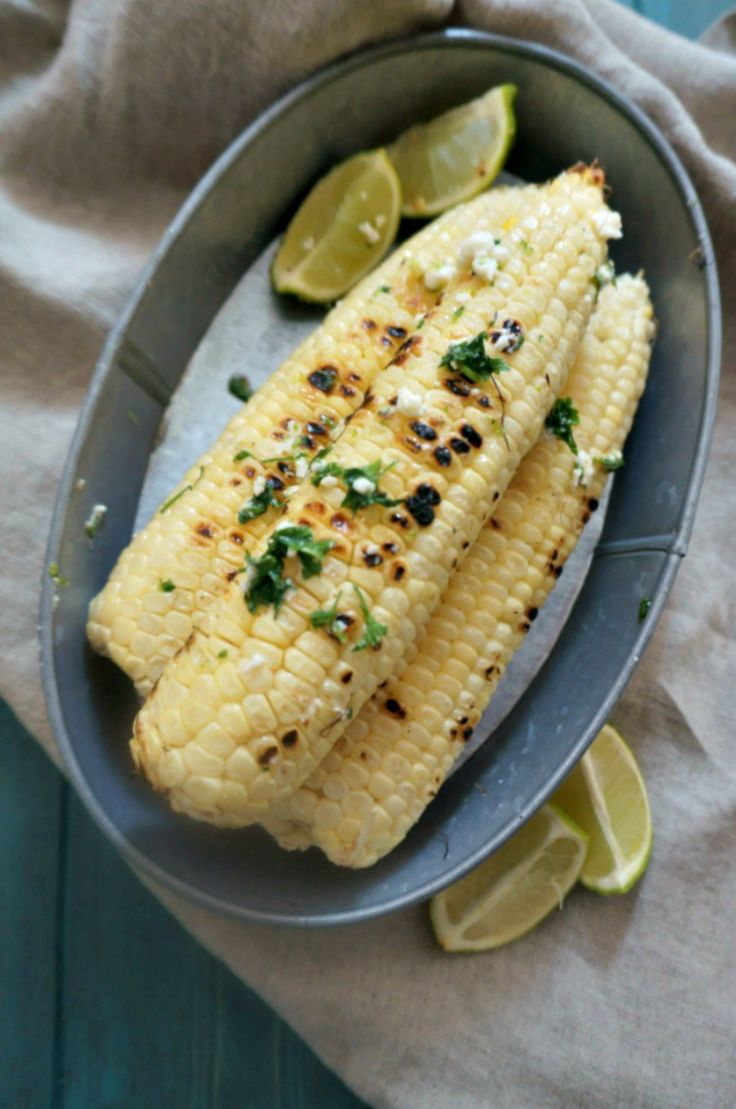 Cilantro Lime Grilled Corn: Sweet summer corn has been grilled and then tossed in a cilantro lime butter and fresh minced cilantro--for a messy, but tasty side dish. #VIVACleansLikeCloth