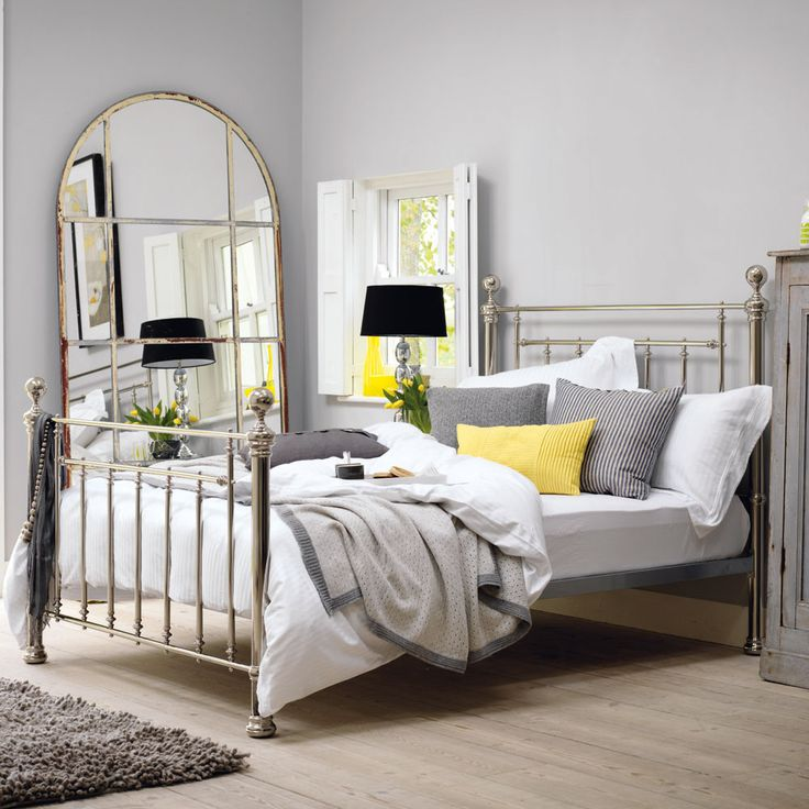 Pop of yellow lifts the grey / neutrals. (Henley Bedstead Nickel by Feather & Black)