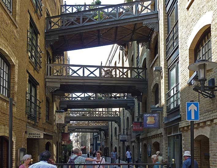 Shad Thames is a street of old warehouses that starts at the southern end of Tower Bridge, runs east and then makes a right-angled turn south.