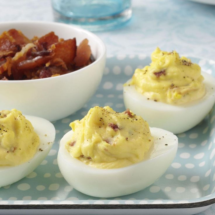 Bacon-Cheddar Deviled Eggs Recipe -I created this recipe a few years ago when I was craving something different to do with hard-cooked eggs. I combined three of my favorite foods - bacon, eggs and cheese - in these deviled eggs. I've shared them at parties and have received many compliments on their eggstra special taste. —Laura LeMay, Deerfield Beach, Florida