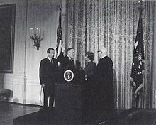 Former Michigan Governor and unsuccessful Republican presidential candidate, GEORGE ROMNEY sworn in as Secretary of Housing and Urban Development on January 22, 1969, with President Richard Nixon and wife, Lenore Romney, at his side.