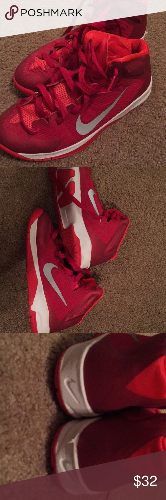 Boys hightop Nike tennis shoes, size 4 1/2 Excellent condition boys red and white Nike high top tennis shoes, size 4 1/2, comes from a smoke free home. Nike Shoes Sneakers