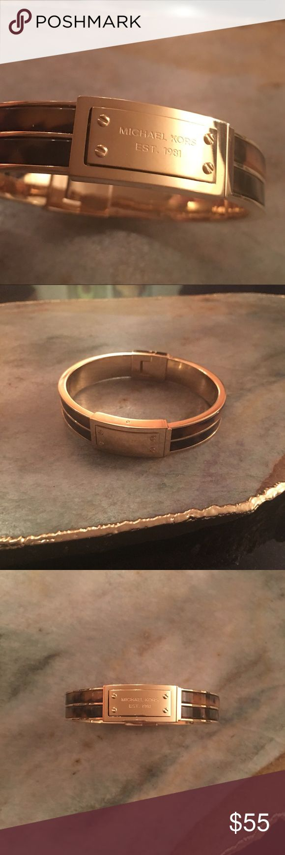 Michael Khors Tortoise Bangle Michael Kors hinged bangle. Gold and tortoise. Michael Kors Jewelry Bracelets