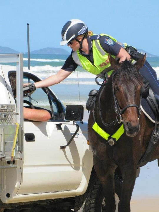 tough job!!  Breath testing on the beach Fraser Island.....you can drive on the beach there.....
