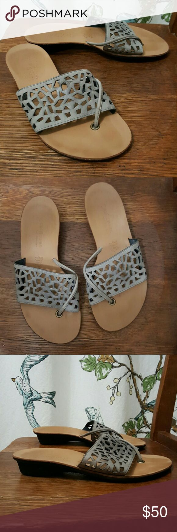Paul green hillary sandals laser cut Laser cut leather slide thong sandals. The color on these is taupe , in some lights it looks grey. They are in very good condition,  tiny bit of wear at bottom edge of heel. Looks like they were worn maybe once or twice. Paul Green Shoes Sandals