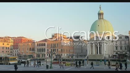 VENICE, ITALY - FEBRUARY 16, 2015: Timelapse of people and water traffic in the city. Scene with old Venetian architecture and people walking along the Grand Canal with sailing transport HD Stock Footage Clip. Medium shot. 2016-01-20, ITALY.