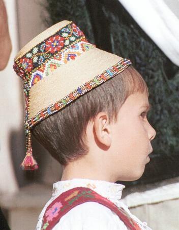 Romanian costume Maramureş  Small straw hat (clop) decorated with rows of small multicoloured beads and worn in Maramureş   Photo taken in Bârsana, Valea Izei, Maramureş
