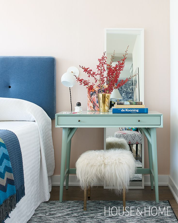 Muted pink and turquoise hues in the bedroom keep the look calm and serene. | Photographer: Alex Lukey