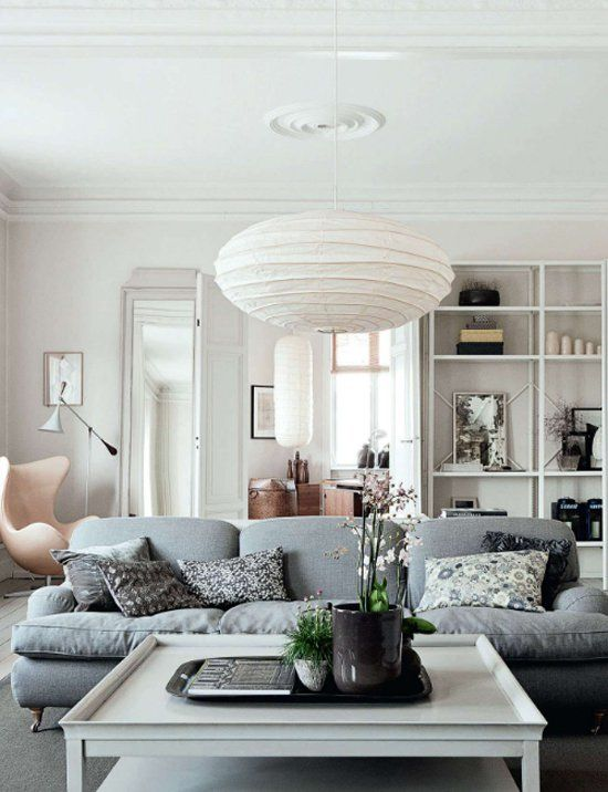 Calm and beautiful white living room with grey sofa in the center @pattonmelo