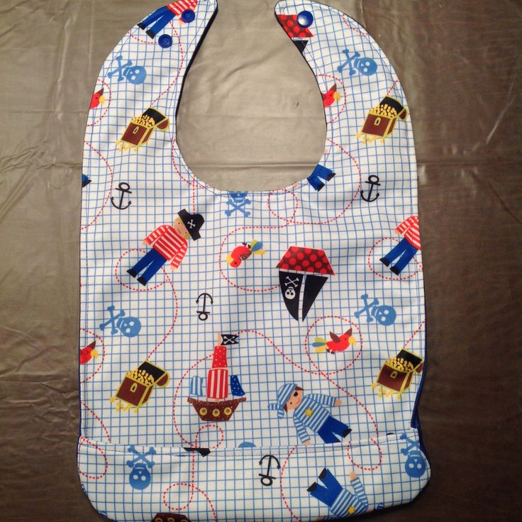 BABY BIB MADE OF 100% PUL DOUBLE SIDED WITH POCKET. https://www.etsy.com/your/shops/QuiltsandSewsShop/tools/listings/400164881