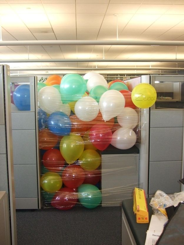 Make any co-worker feel special with a personalized balloon pit! | 15 Wildest Office Pranks