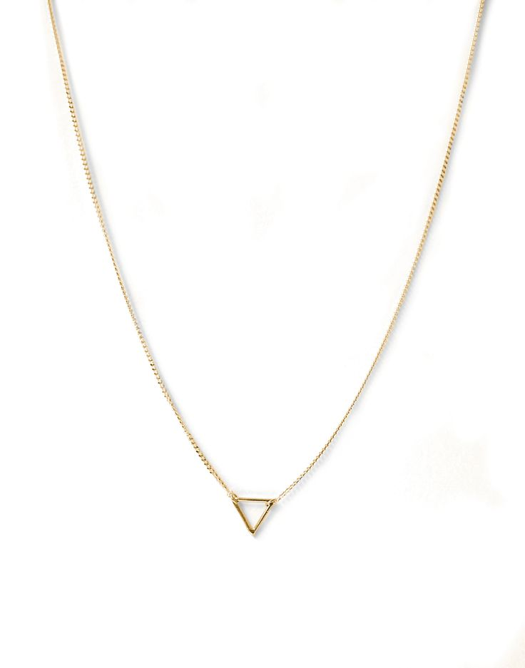 Tiny Triangle Necklace by Natalie Marie Jewellery.  Another beautiful, delicate and timeless piece that comes in gold, rose gold, or silver. We've fallen for Natalie Marie Jewellery big time.