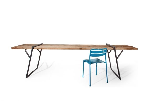 "The Quadra Table by Luis Arrivillaga praises convenience. The design fits in with charming and gets along well with chic, crossing paths of farmhouse table meets utility folding table. Love the clever construction of the ""legs""."