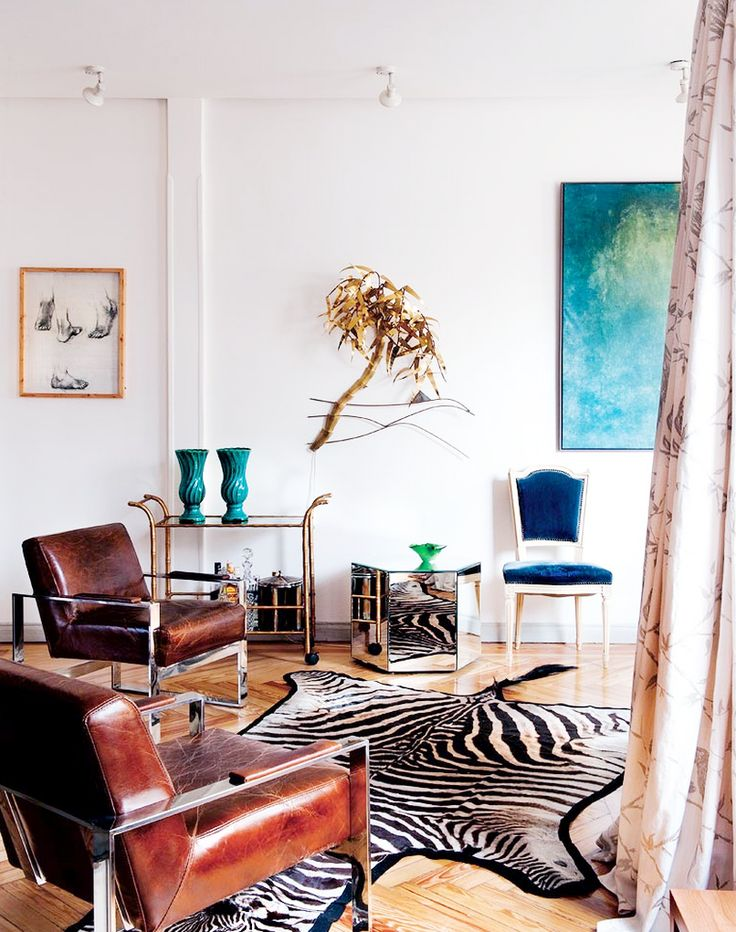 Tour a Fashion Designers Feminine Abode// zebra hide, brass sculptureDecor Ideas, Livingroom, Zebras Rugs, Living Room, Hands Beads Chairs, African Décor, House, Leather Chairs, African Design