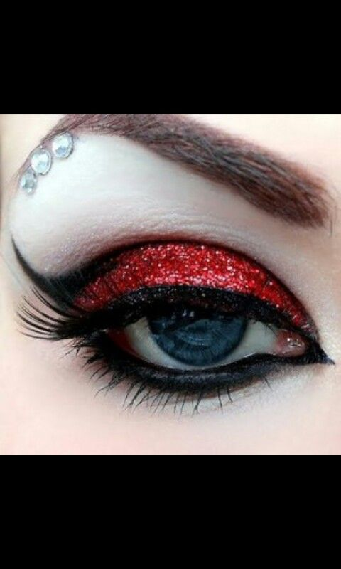 Red sparkle Silver jewels  Black eyeliner Fake lashes Still pretty