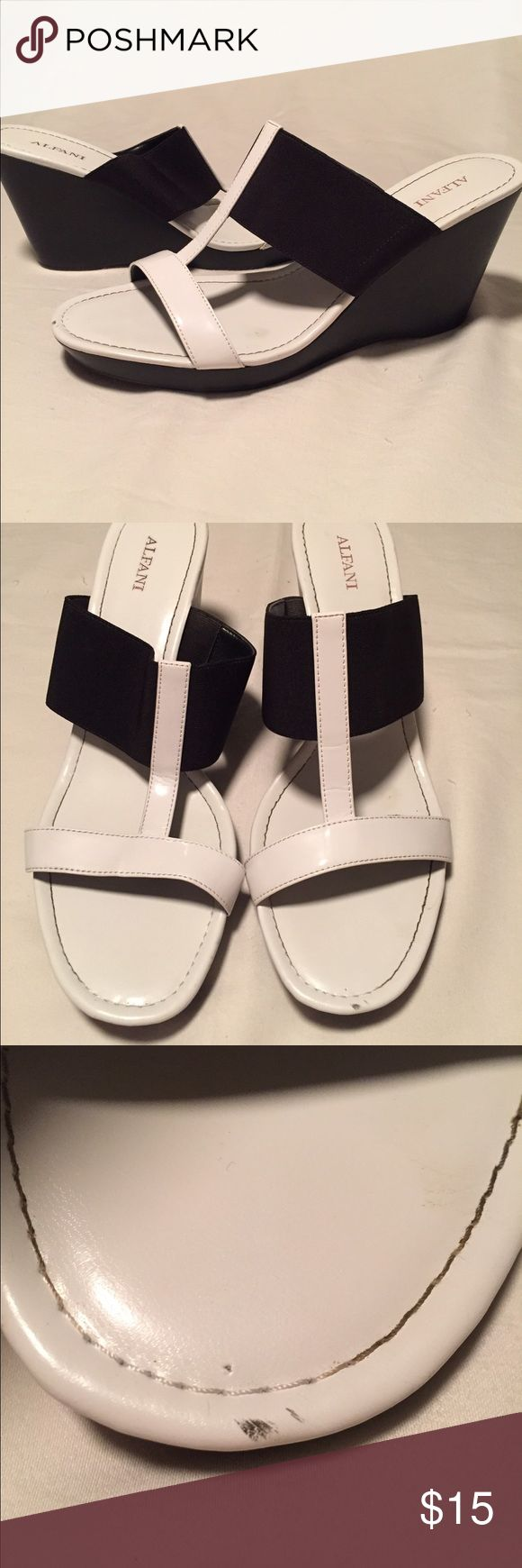 "Alfani Black and White Wedge Sandal This is a black and white wedge sandal, perfect for summer wear!  Very comfortable, has a small smudge on the left toe as pictured.  Size 10M w/a 3.5"" wedge. Alfani Shoes Wedges"