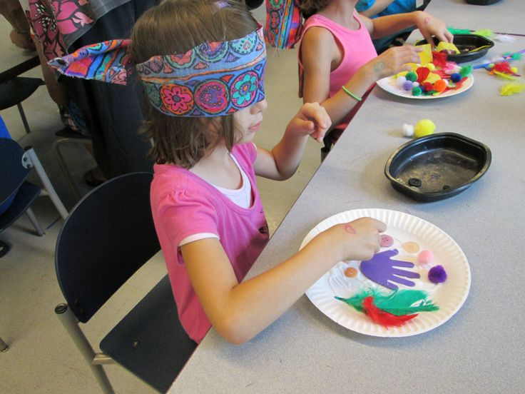 Blindfold art! We read Helen's Big World about Helen Keller and then blindfolded the kids and gave them materials to make art with. We just put glue on the paper plate for them, they did the rest. They LOVED it.