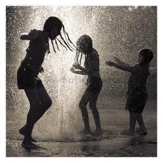 Who couldn't be filled with joy while playing in a sprinkler!