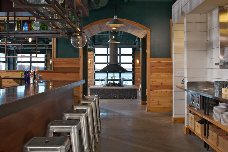 Barrelback restaurant, Walloon Lake, Michigan. concrete floors, custom bar with suspended metal cage shelving, cedar walls, gorgeous views of Walloon Lake