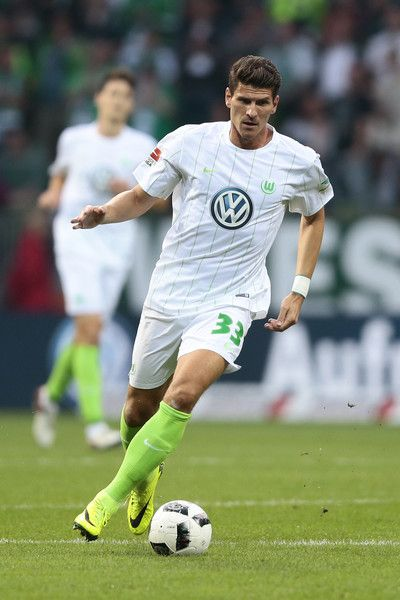 Mario Gomez of Wolfsburg in action during the Bundesliga match between Werder Bremen and VfL Wolfsburg at Weserstadion on September 24, 2016 in Bremen, Germany.