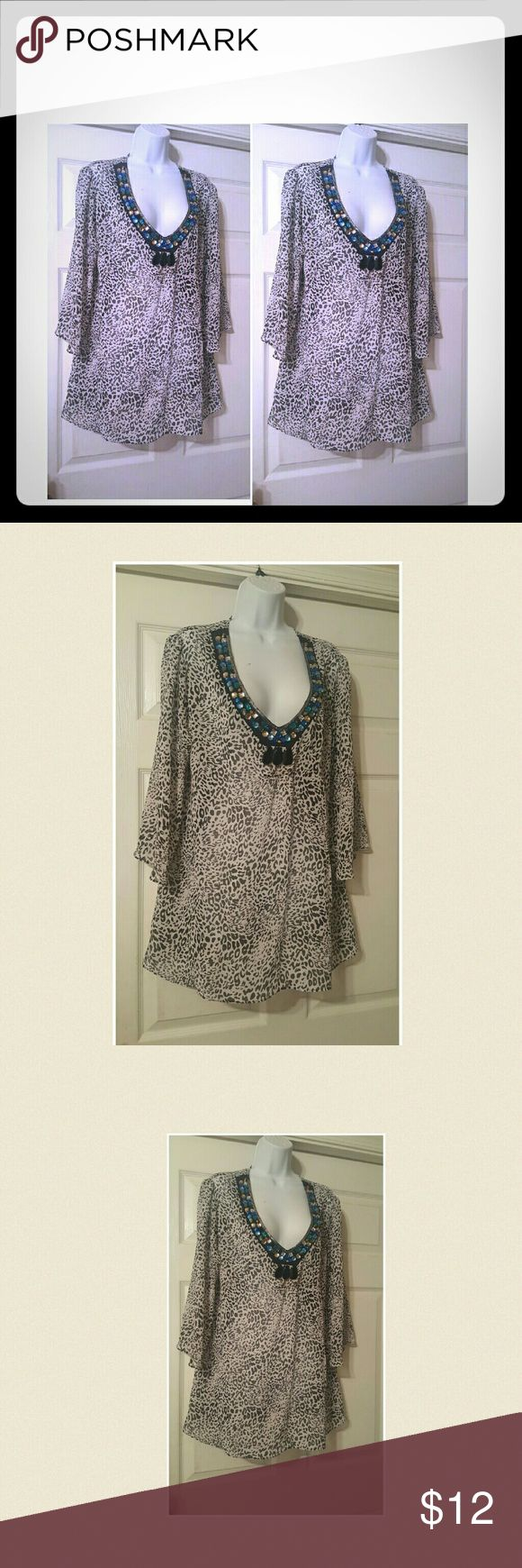 Black& white leopard print tunic top Black and white leopard print tunic top with embellished vneckline and 3/4 length sleeves. Top is in excellent like new condition Tops Tunics