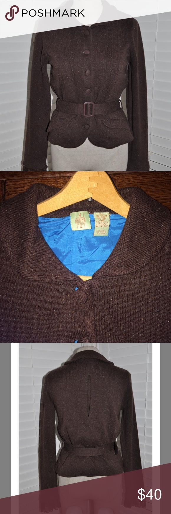 Anthropologie HWR Tweed Occidental Jacket Cardigan By Monogram from Anthropologie. This chocolate tweed jacket exudes feminine grace.  Lace cuffs, and an inverted back pleat to contour the waist. Silky turquoise blue lining. Removable Belt is adjustable. Two shallow front pockets. Cotton, Acrylic, wool, silk blend. Lining is 100% acetate. Dry clean. I believe this is Vintage Anthropologie, from 2005. I think i did wear it once, but it is in excellent condition. I can find no flaws…