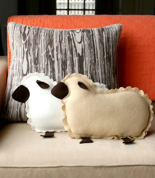 Lamb Pillows Adorn your couch and really decorate your living room with adorable lamb pillows. These pillows are made from felt and can be sewn or you could use fabric glue if you prefer. They look adorable on the couch or living room chairs or you could make them for the kids' bedrooms. Get really creative and make several out of different colors or just stick with basic sheep colors – it's all up to you.