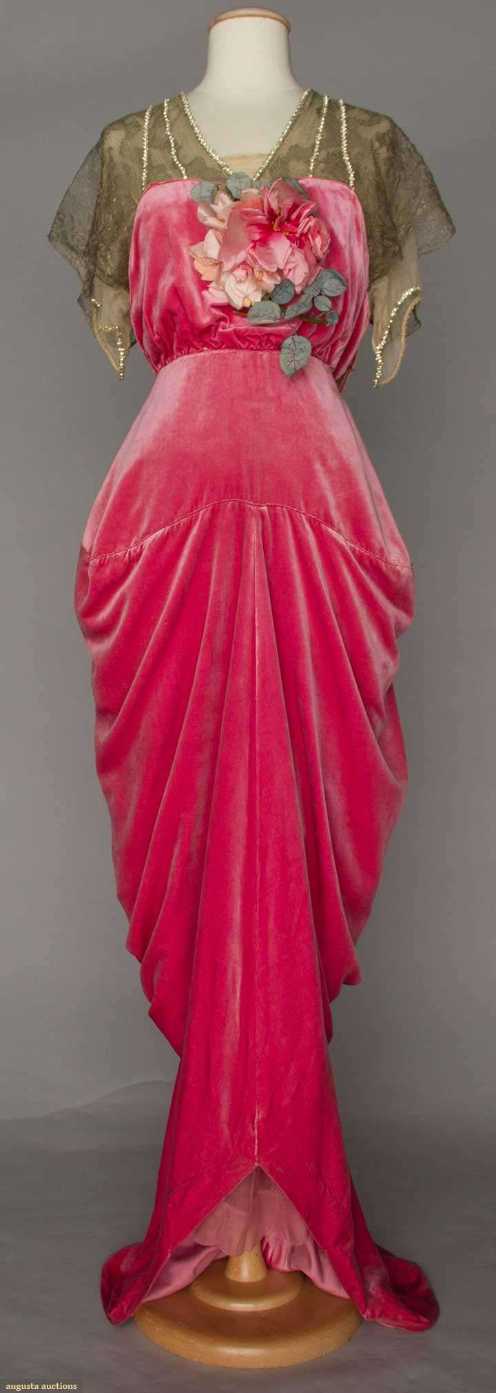 "RASPBERRY VELVET HOBBLE SKIRT GOWN, PARIS, 1910-1914 Silk velvet, upper bodice of gold lace over chiffon trimmed w/ rhinestone bands, silk blossom corsage, trained skirt narrows to ankles, label ""Robert, Paris"","