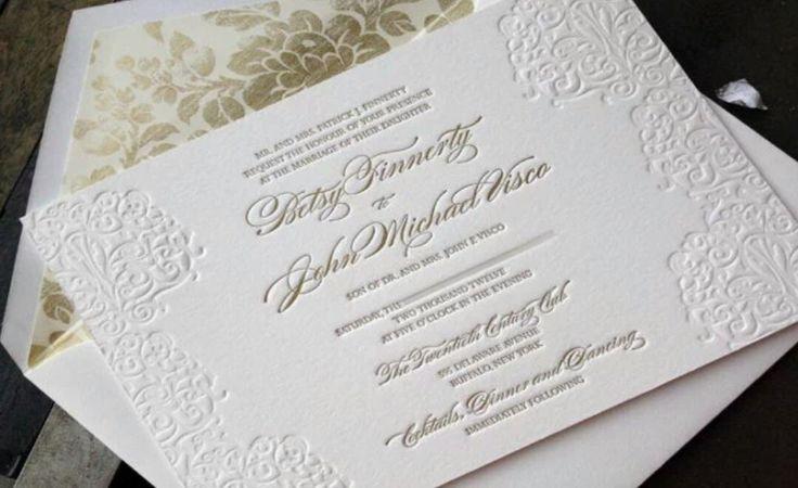 Classic and elegant wedding invitation with gold flower inner envelope.