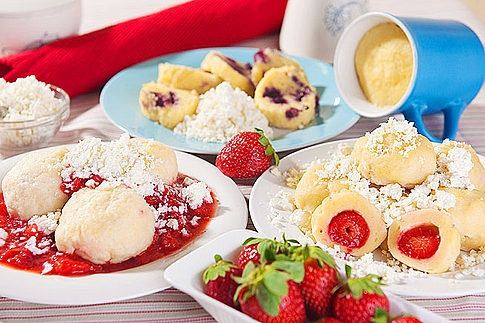 Various kinds of fruit dumplings - another of Czech sweet main dishes. Served with a lot of butter, powder sugar and cottage cheese! Decadent!:)