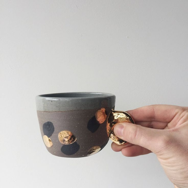 Image of Black dot gold dot and ear handle cup