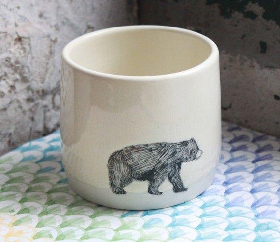 Bear Mug and Penguin mugs with handles, both yellow.