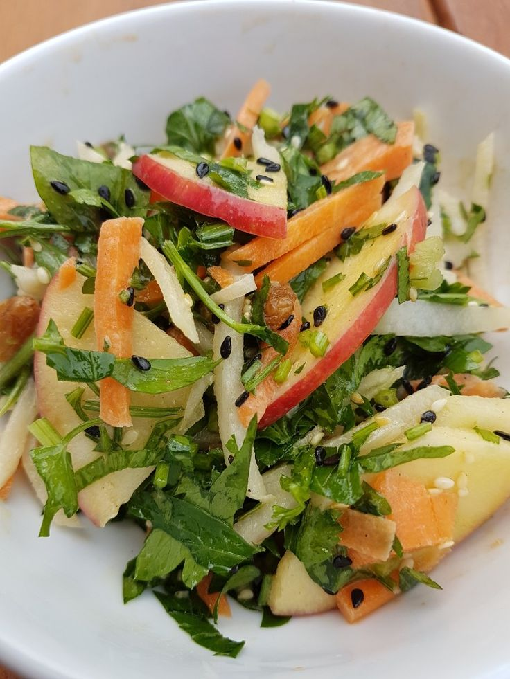 Moorish crunch salad with apple, radish and carrot with herbs, dried fruit, seeds and tahini dressing