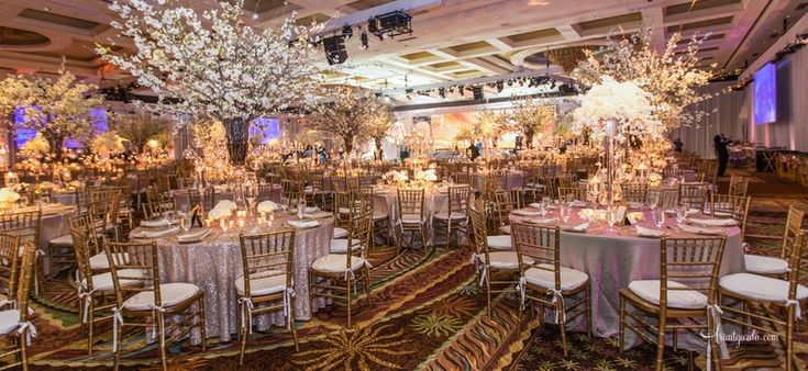 Cherry Blossom Trees at Elegant Ballroom Reception | Photo: Studio AvantGarda.