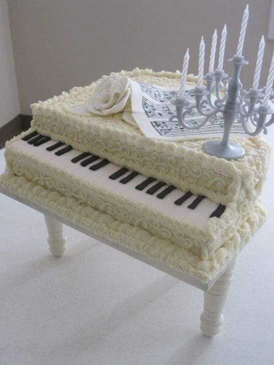 Piano Cake ... Change it to black for a Grooms Cake.  FROM: http://media-cache-ec0.pinimg.com/originals/e7/99/06/e7990638f4b76e8f28bf35eebeecdb68.jpg