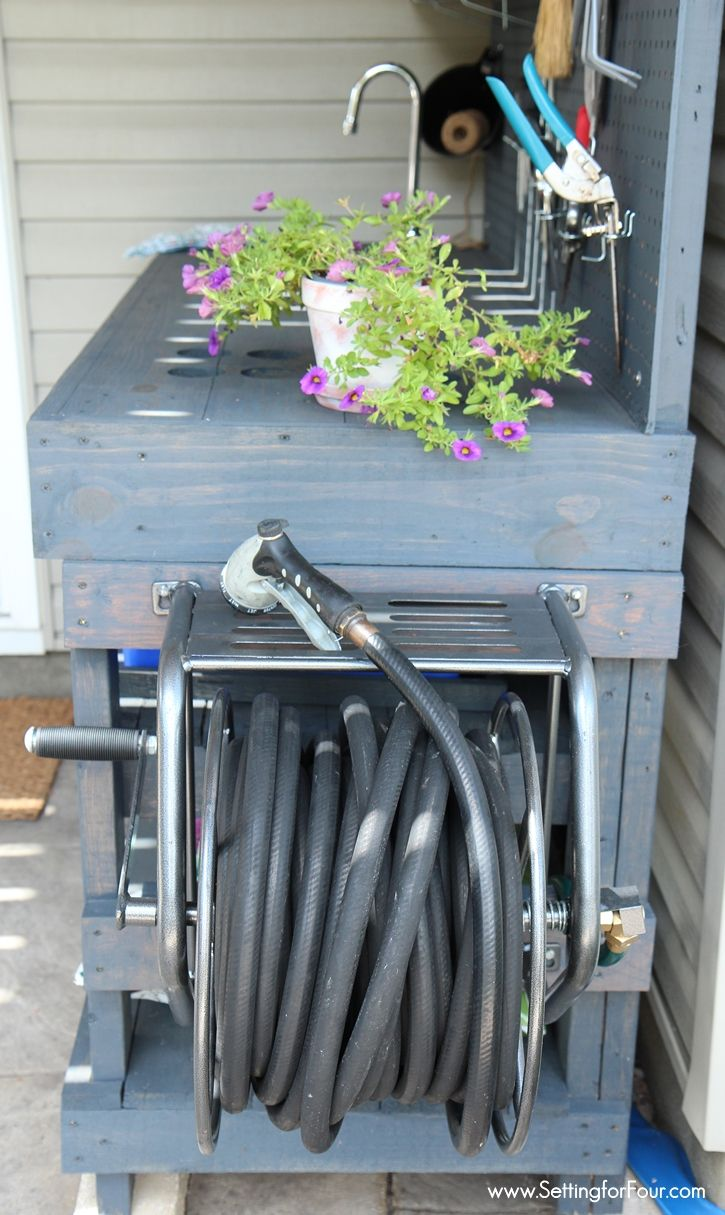 Love to garden? This DIY Pallet Wood Potting bench was so inexpensive to make and has all the bells and whistles! Like a Mounted Hose Reel with Gardening Hose connected to a water supply for watering my flowers and gardens! See instructions and supply list at www.settingforfour.com