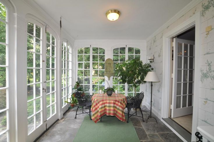 French doors enclose porch house with porch french