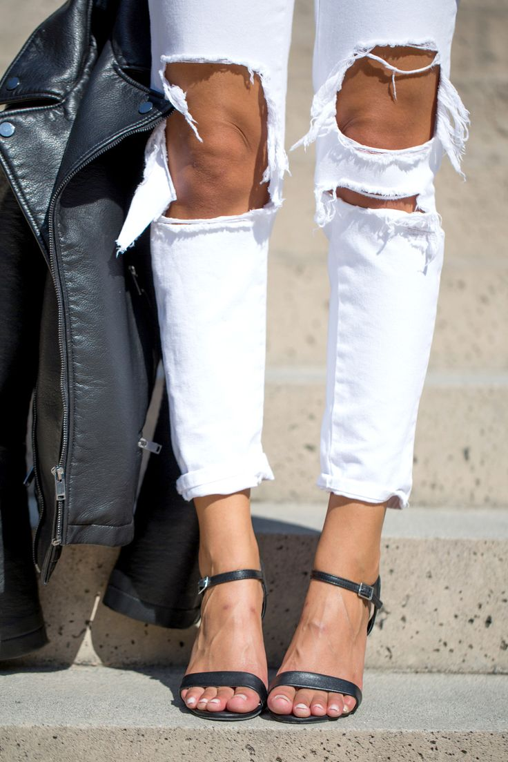 Black and white outfit, ripped denim, leather jacket…