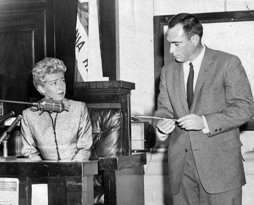 Lana Turner testifying at the murder trial of her daughter, Cheryl Crane, who she watched knife Johnny Stompanato to death. Although she testified for 62 minutes, when the Deputy District Attorney showed her the knife she could not look at it.