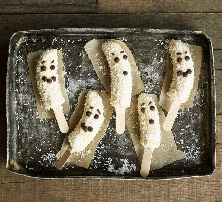 Frozen banana ghosts. Bananas taste spookily like creamy ice cream when frozen in ghostly robes of white chocolate - quick and easy, with just 4 ingredients!