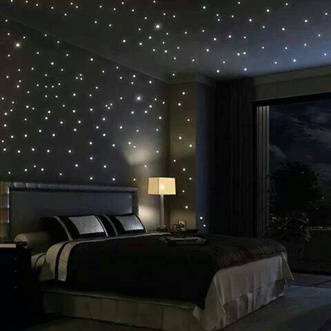 Relaxing in star filled room listening to Titanic Theme song - D would be in heaven.  He even has a captain's bed and space-themed bedding to top it all off!  Just need to add planets and Titanic ship replica