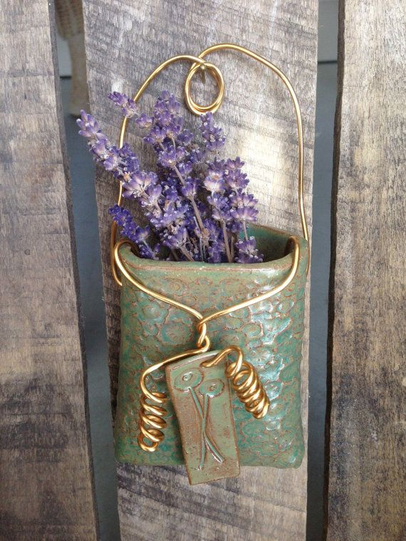 green pebbled wall pocket with gold colored by
