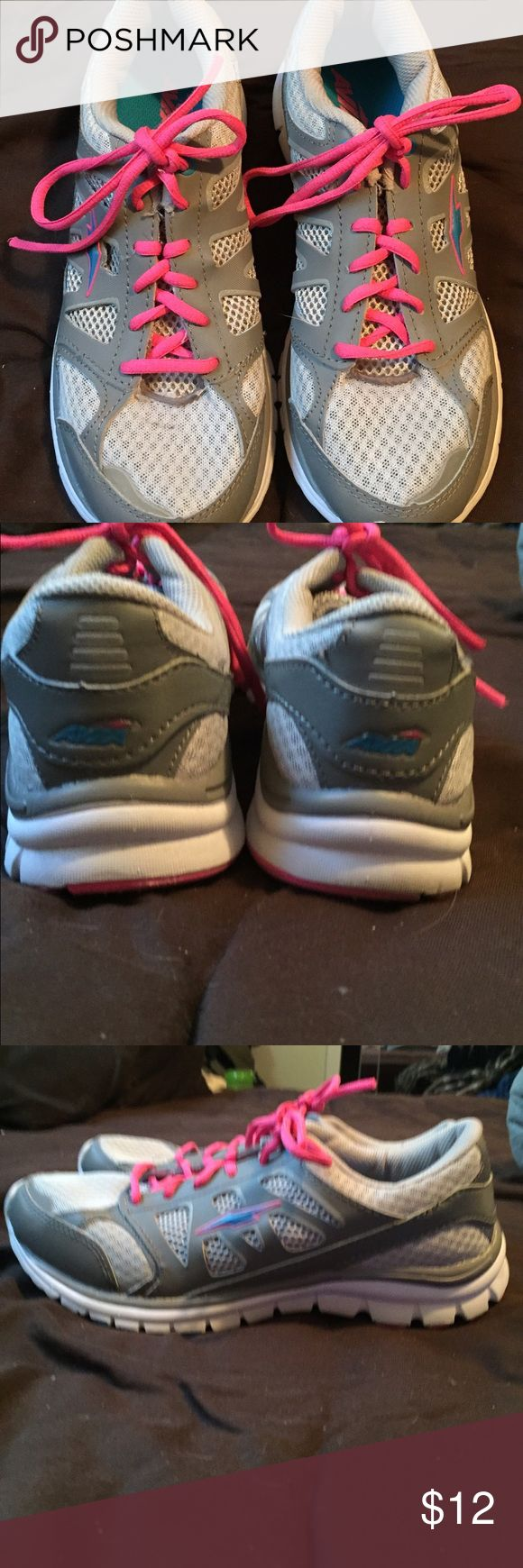 Avia NWOT very cute pink/gray running shoes Avia NWOT very cute pink/gray running shoes.  Brand new.. Clean sole.. Lightweight and comfy.  Goes with everything Bc of the gray color .. You can change laces if you want!! Avia Shoes Athletic Shoes