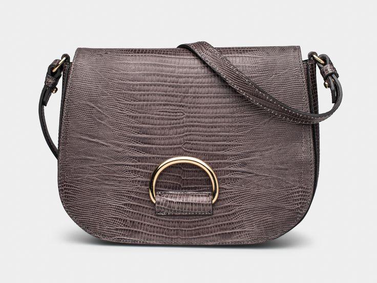 D Saddle Medium Greyish Brown Lizard, available at GOOP; https://shop.goop.com/shop/products/d-saddle-medium-handbag?taxon_id=1491